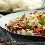 Crab salad with vegetables, radish, carrots, mango, pine nuts and prawn crackers